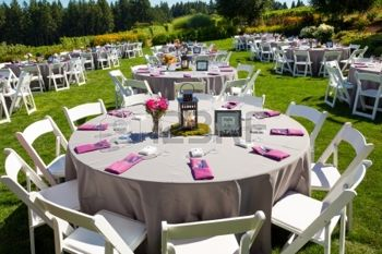 21477588-tables-chairs-decor-and-decorations-at-a-wedding-reception-at-an-outdoor-venue-vineyard-winery-in-or.jpg